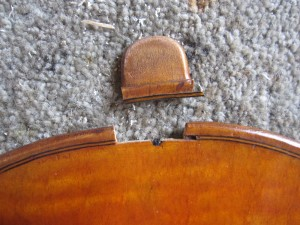 this is a broken violin button I had to repair so that the instrument could be set up to a satisfactory standard again